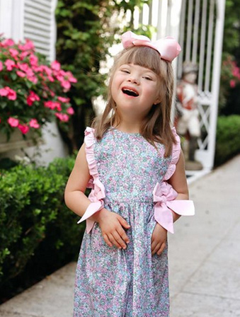 adorable little girl in floral summer dress