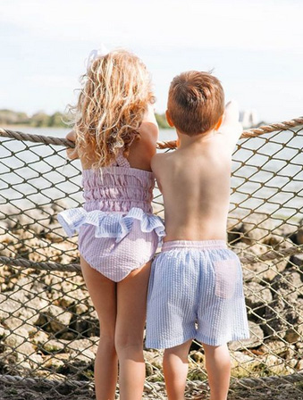 boy and girl in smocked swimsuit and swim trunks