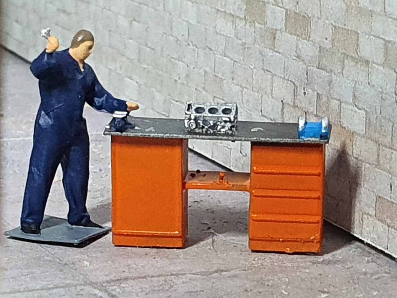 Resin printed figure and highly detailed workbench. Hand Painted
