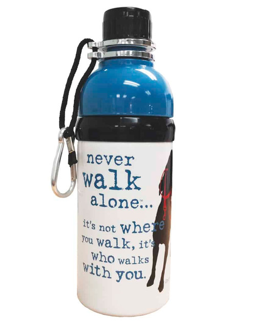 """A Dog is Good water bottle. Top cap is black. Below the neck and the top third of the bottle  it's a solid royal  blue. Below that on top of a white background, the words in royal blue font """"never walk alone...it's not where you walk, it's who walks with you"""" is next to an image of a black dog wearing a red harness."""
