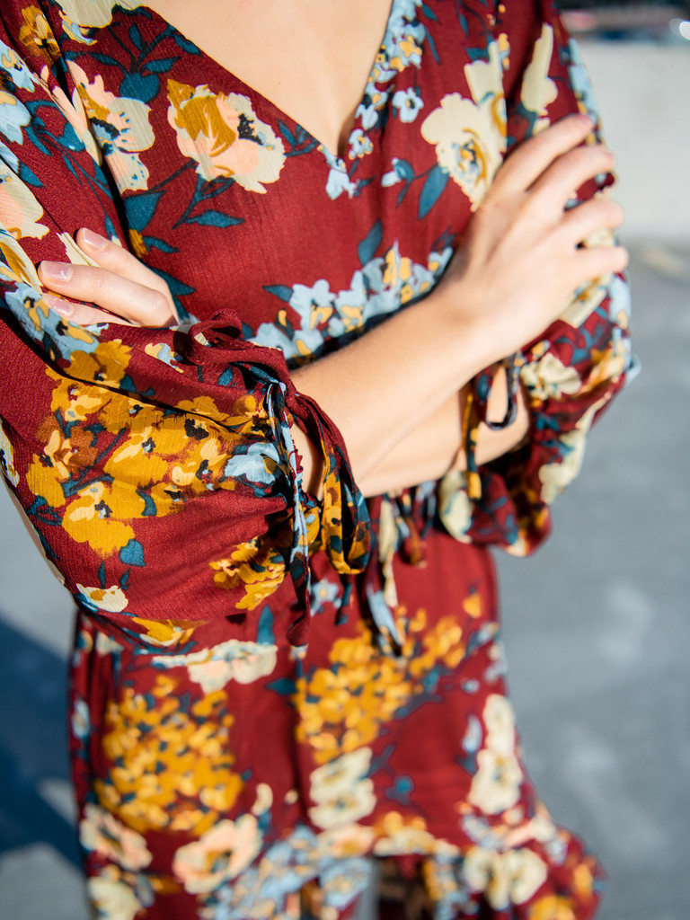 Close up on The Bonnie Floral High Low Maxi Dress in Burgundy