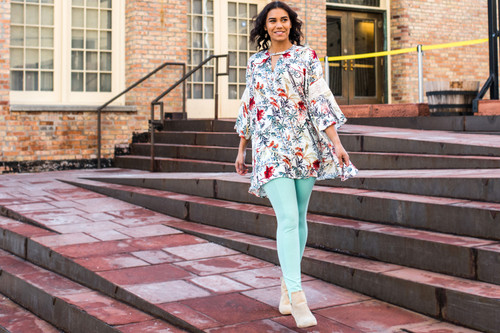 The Lila Floral Keyhole Top with Lace Bell Sleeves (paired with our Mint Leggings)
