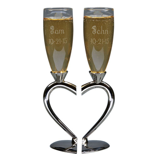 A pair of personalized toasting goblets with a heart shaped base.