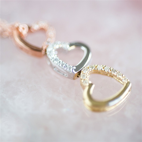 Three heart gold and diamond necklace