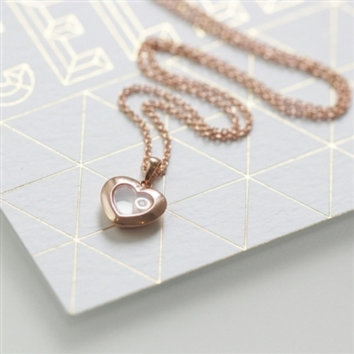 Rose Gold and floating Diamond Heart necklace in an engraved gift box