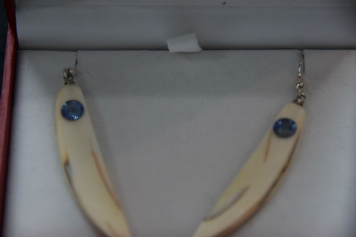 Alaskan Native crafted ivory with round purple/blue natural Tanzanite as center stones of earring set