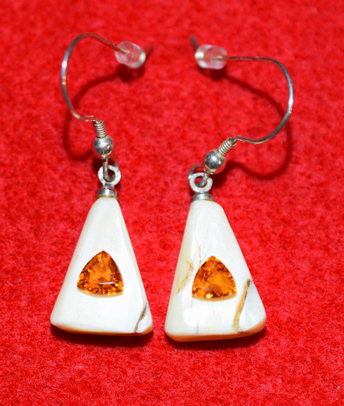 Alaskan Native crafted ivory with a set of stunning, natural Red Nigerian Spessartite trillion cut center stones as the focal point of this unique earring set