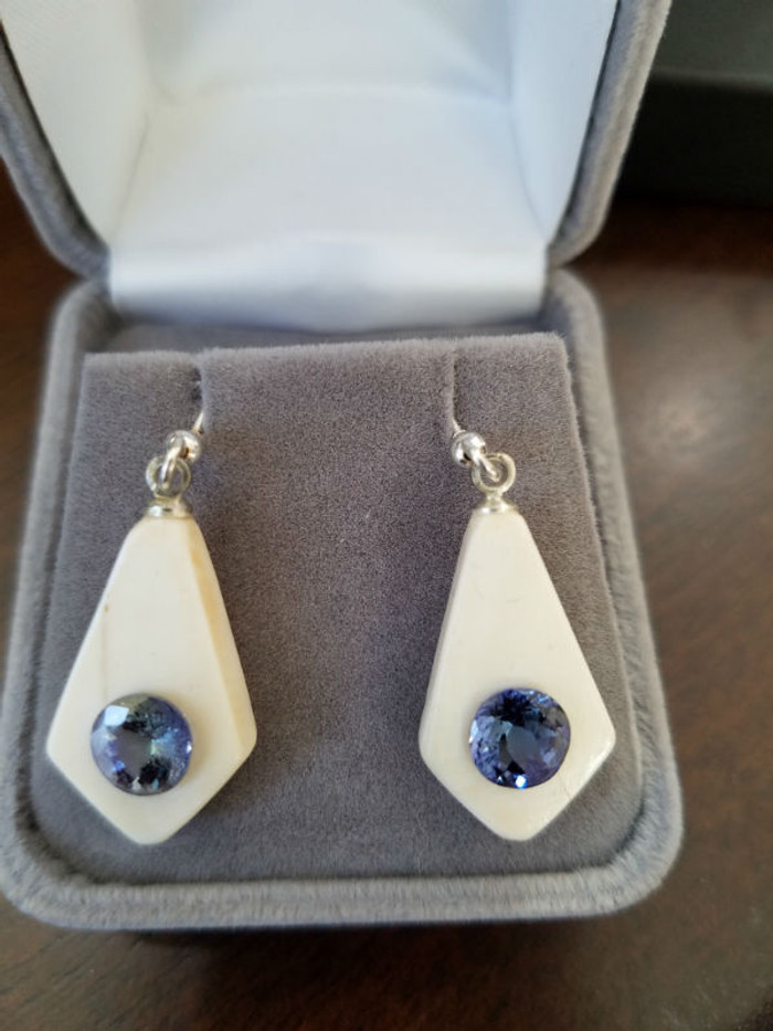 Alaskan Native crafted ivory with a sparkling round shaped natural Tanzanite as center stone of earring set