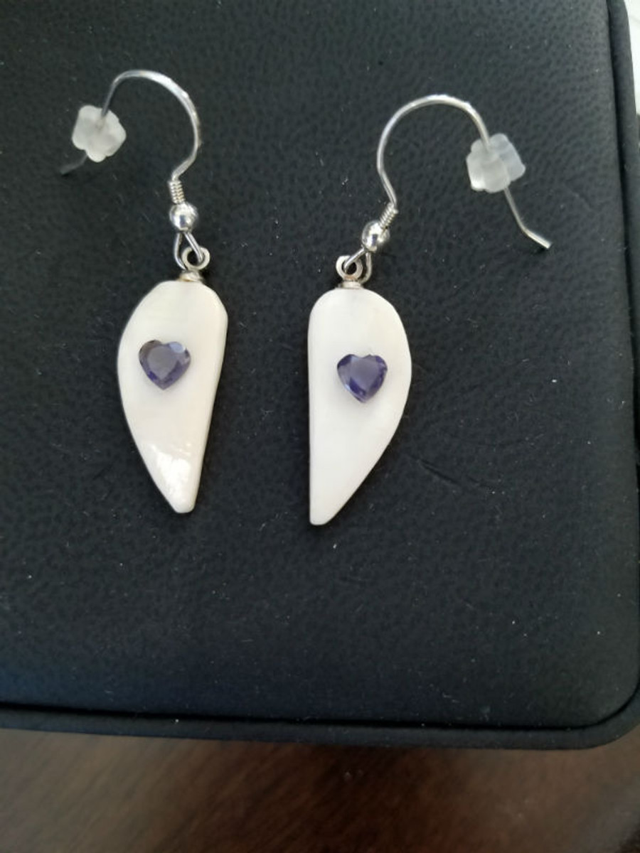 Alaskan Native crafted ivory with heart-shaped natural Iolite as center stone of earring set