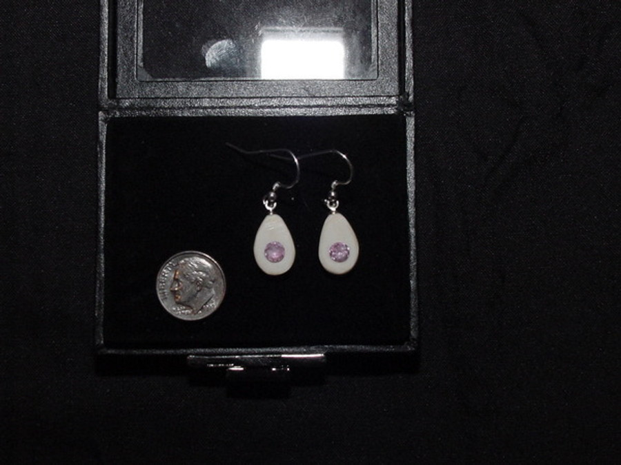 Alaskan Native crafted ivory with round cut natural bright purple pink tourmaline as center stones of this earring set.
