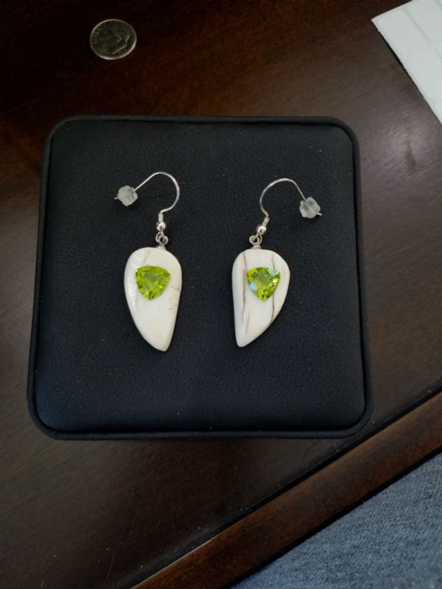 Alaskan Native crafted ivory with natural green Peridot Trillion Cut gems in a unique and stunning earring set