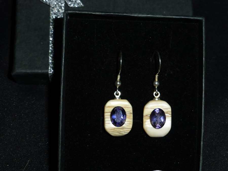 Alaskan Native crafted ivory with oval-shaped natural Iolite as center stone of this earring set