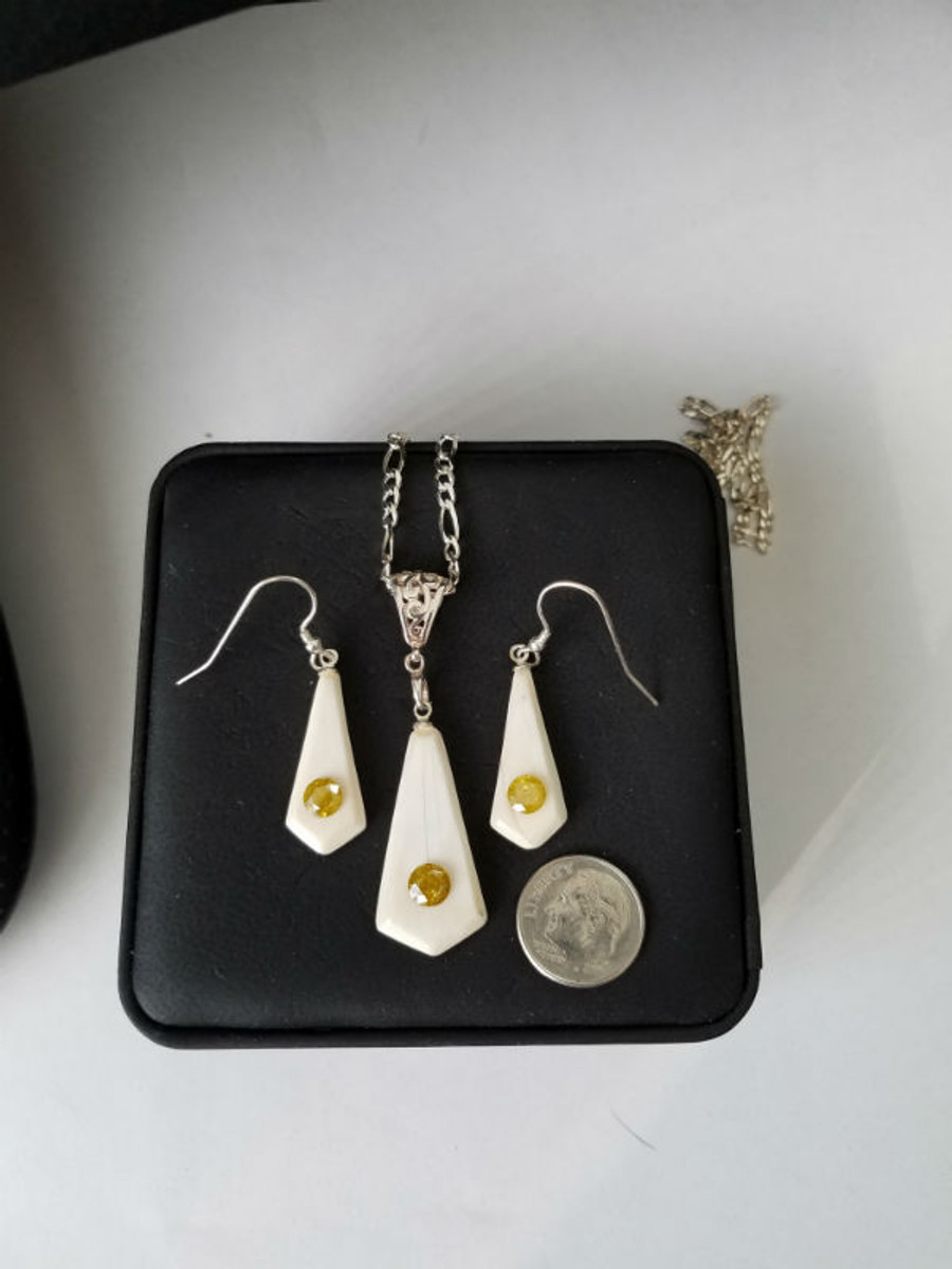 Alaskan Native crafted ivory and natural yellow diamond earring & pendant matching set.