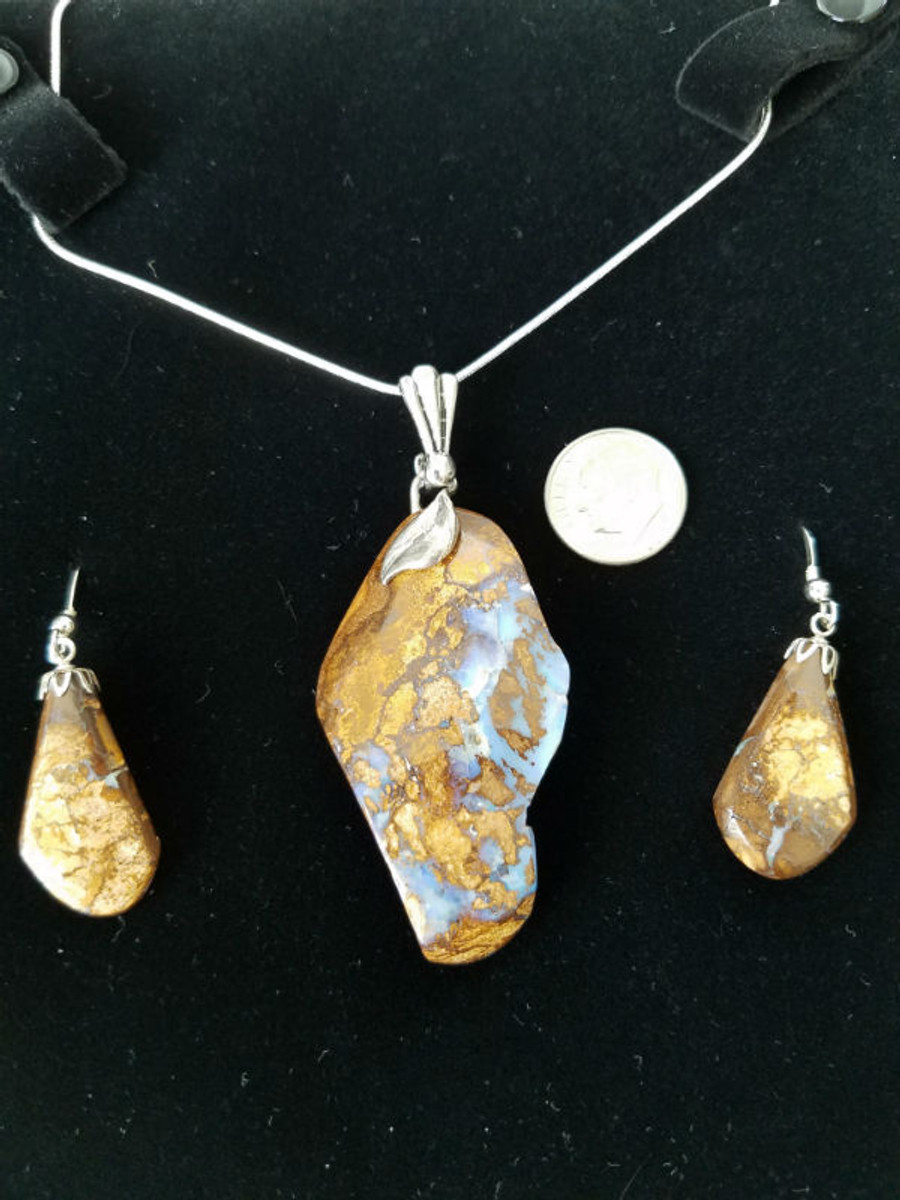 Stunning Alaskan Native crafted Cabochon Collection cut from Australian Boulder Opal to make this unique Jewelry Set