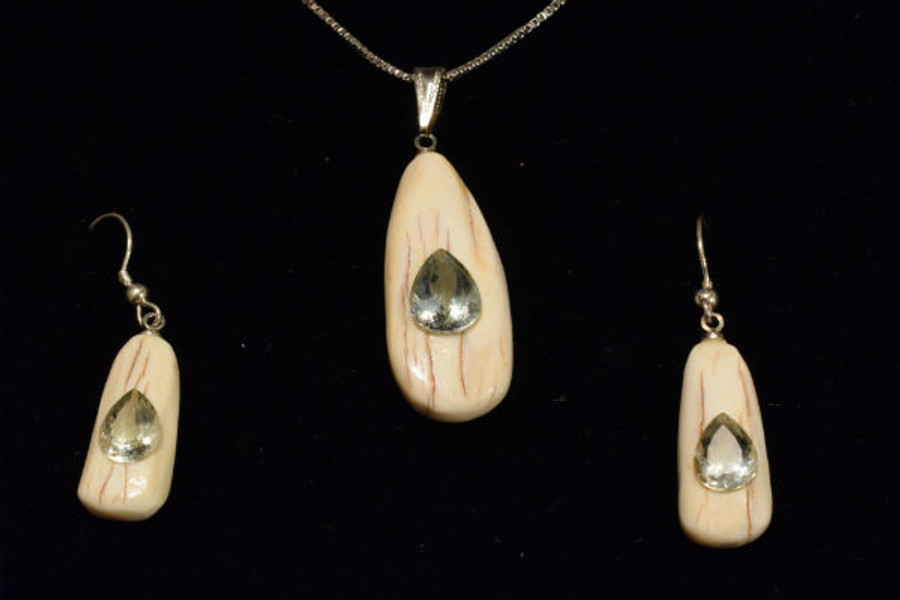 Alaskan Native crafted ivory with pear cut natural green Beryl as center stones of this stunning earring pendant set