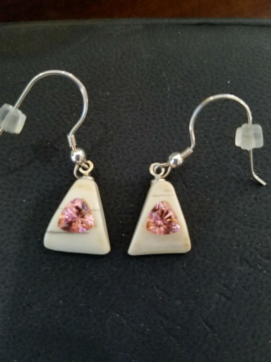 Alaskan Native crafted ivory with bubblegum pink, man-made Yag trillion gems as the stunning center stones of this beautiful earring set