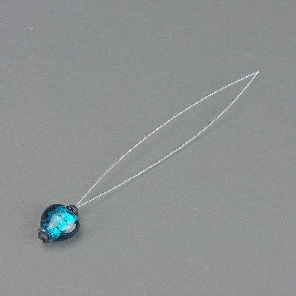 Turquoise glass bead.