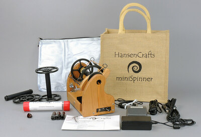 The Ultimate E-Spinner, the HansenCrafts miniSpinner Pro, in Cherry! The Pro includes 2 additional HansenCrafts Standard or 3 additional HansenCrafts Lace bobbins, gear bag, maintenance kit, and orifice reducer set.