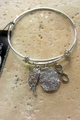 RUE 21 CHARM BRACELET WITH: INFINITY, WING, AND MEDALLION. COLOR: SILVER. (G-15)