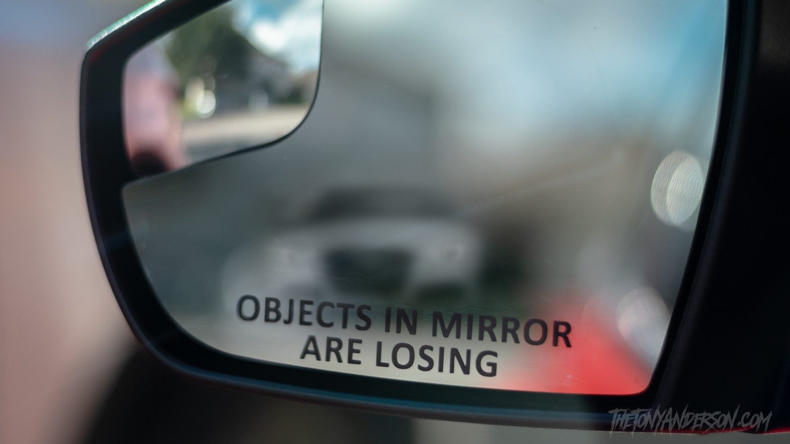 "Mirror saying ""Objects  in Mirror are Losing"""