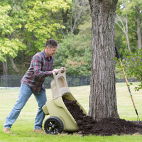 Simplay3 Easy Haul Wheelbarrow with two easy grip handles is easy to tilt and dump mulch, soil, or leaves.