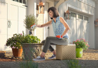 Simplay3 Handy Home 3 Level Seat rotates to three heights for pruning plants and flowers in the garden.