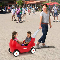 Simplay3 High Back Wagon for toddlers with front caster wheels for easy turns around tight corners.