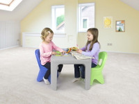 Simplay3 Play Around Table and Chair Set for toddler activities like puzzle solving and arts and crafts.