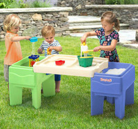 Simplay3 In & Out Activity Table for children encourages fun, interactive outdoor play.