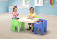 Simplay3 In & Out Activity Table configured as a children's arts and crafts table with colorful, deep storage bins on each side.