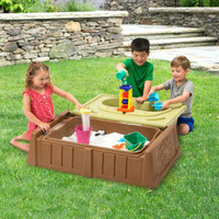 Simplay3 Sand and Water Bench for boys and girls has natural colors that blend with backyard landscapes.