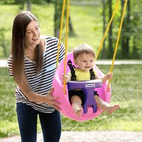 Simplay3 Pink Snuggle Swing attached to swing set with mother pushing child