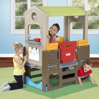Smiling kids playing on Young Explorers Adventure Playhouse.