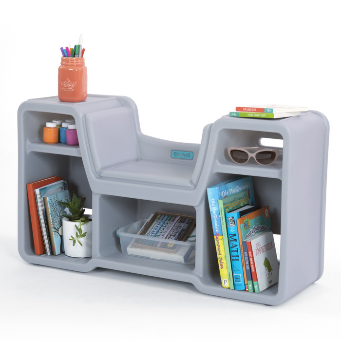 Cozy cubby reading nook has plenty of storage for books, arts & crafts, games, and more.