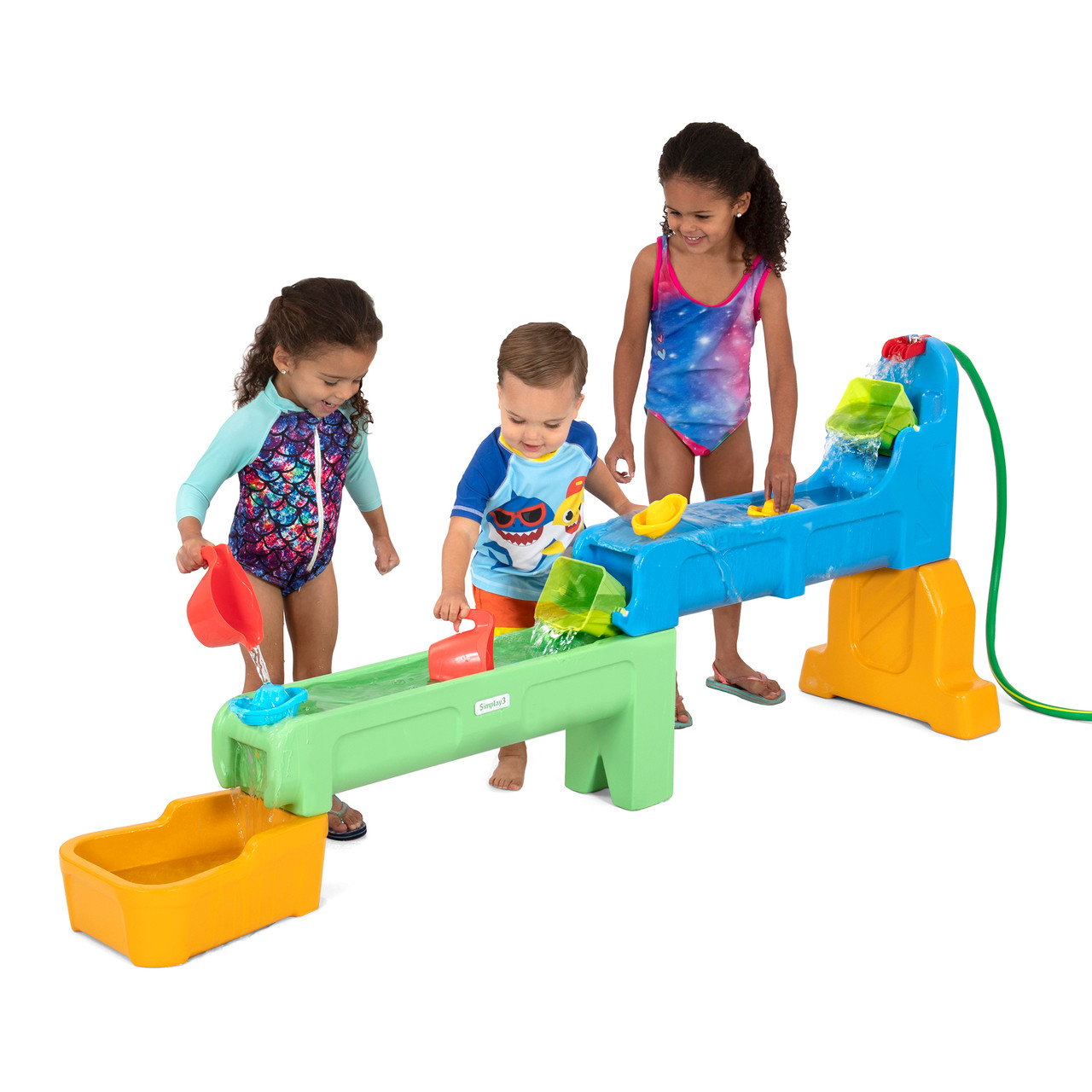 Smiling children enjoying playing with rushing river falls water play table