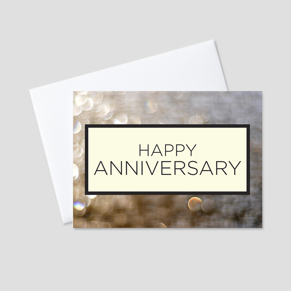 Company Anniversary greeting card featuring Happy Anniversary in a black bordered box surrounded by tan and cream bubble designs