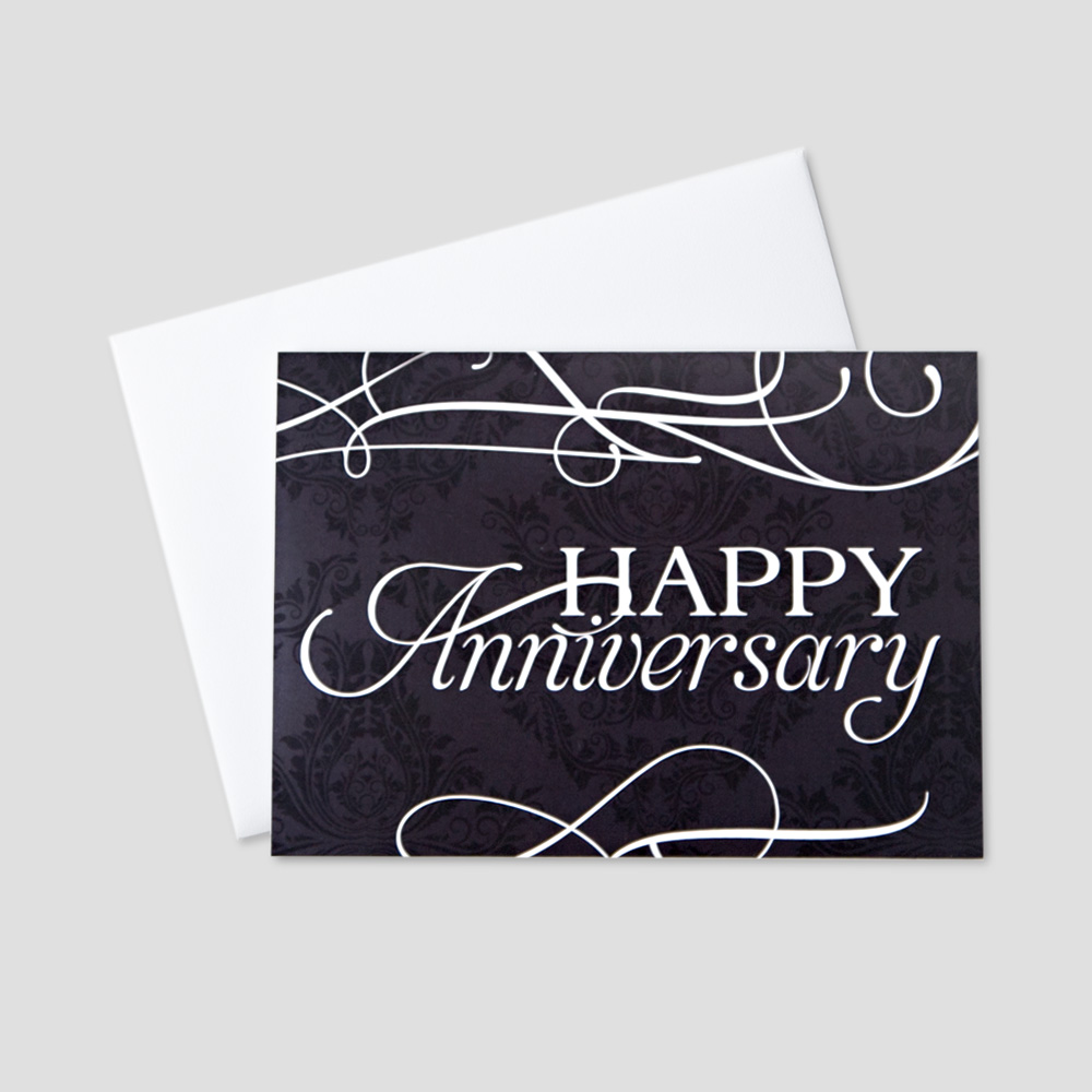 Company Anniversary greeting card featuring Happy Anniversary in a white script font against a navy blue floral background and white swirl designs