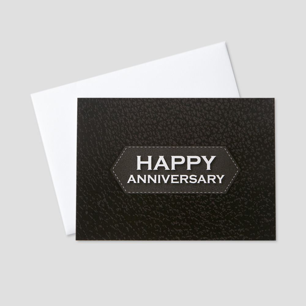Business Anniversary greeting card featuring Happy Anniversary on a black background resembling a leather briefcase