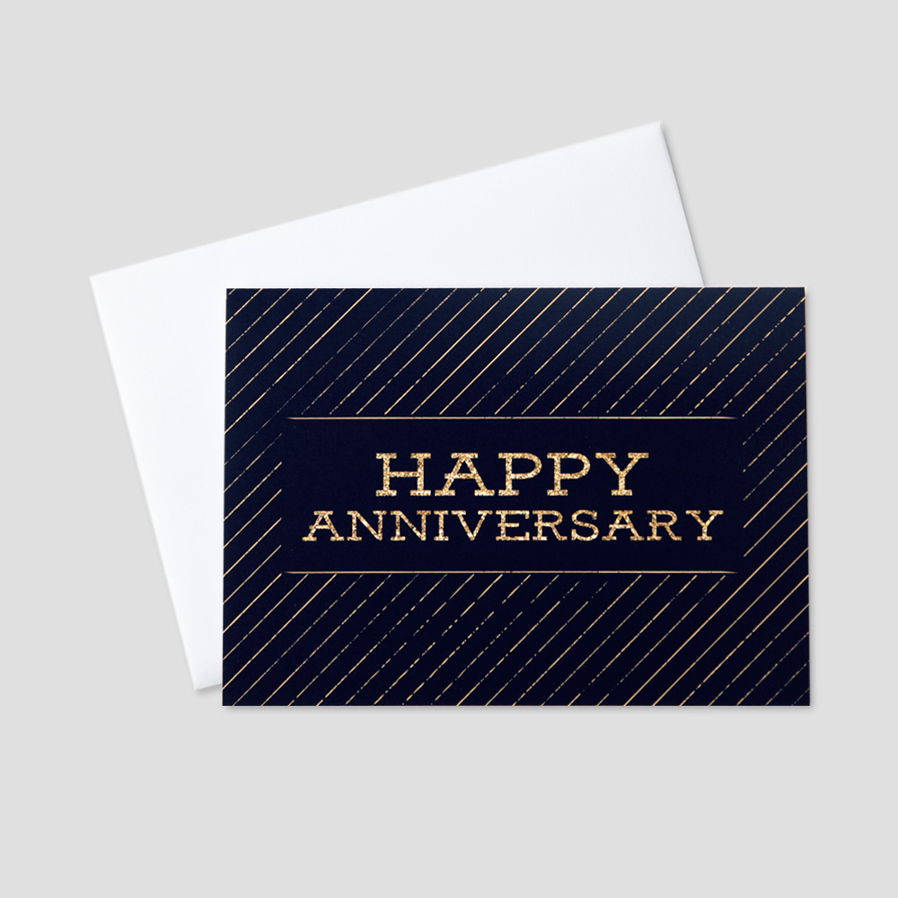 Business Anniversary greeting card with Happy Anniversary written in a golden block font against a black background with golden diagonal stripes
