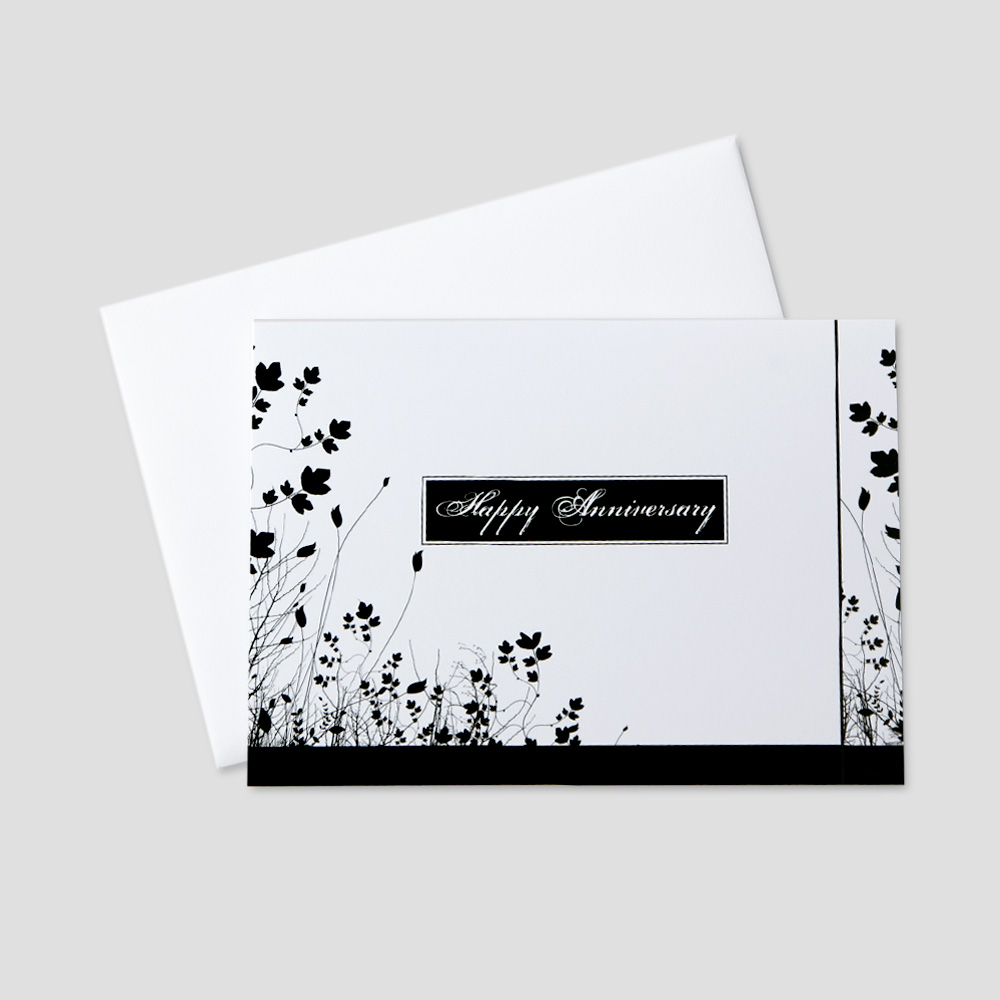 Professional Anniversary greeting card featuring a white background decorated by black floral detail around a happy anniversary message