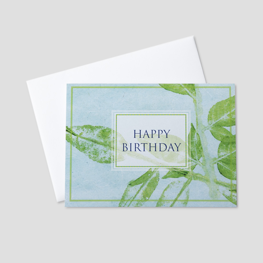 Professional Birthday greeting card featuring a light blue background and green leaf designs