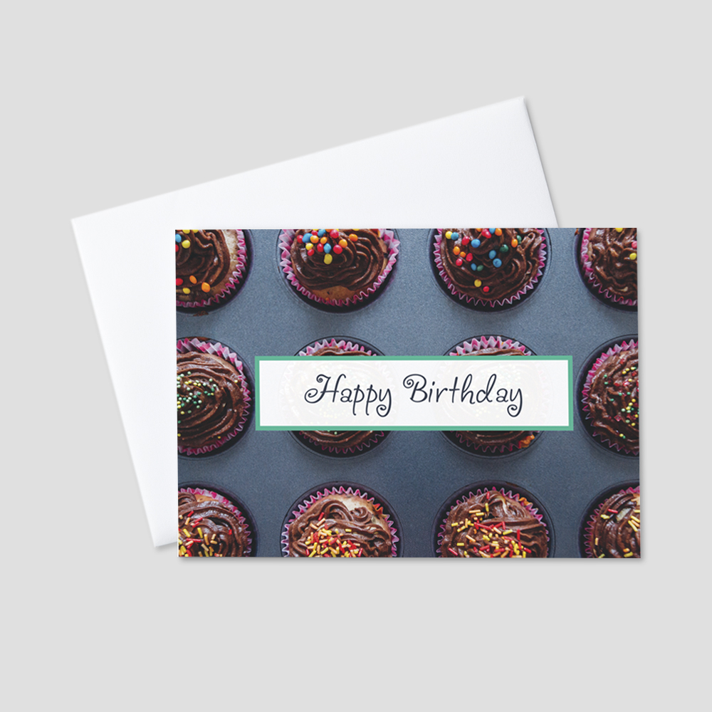 Festive Birthday greeting card featuring a fun Happy Birthday message against a background of delicious, colorful cupcakes