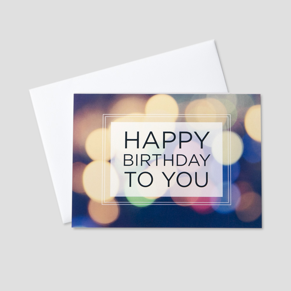 Business birthday greeting card featuring a happy birthday message on a multi-colored light background