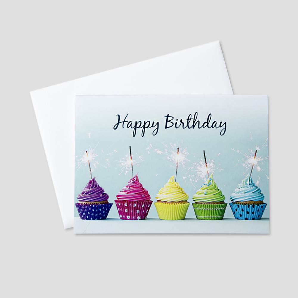 Festive birthday greeting card featuring colorful cupcakes and sparkling candles