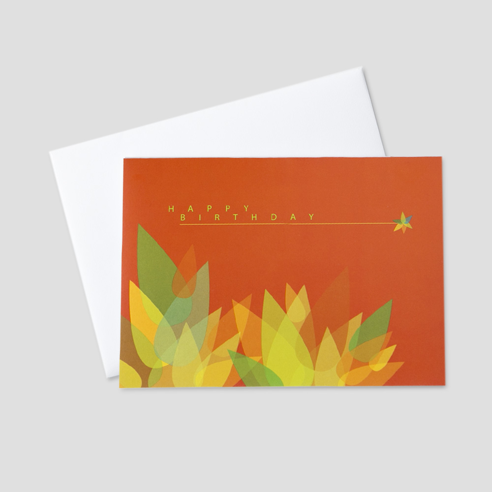 Professional Birthday greeting card with an orange background and colorful green and yellow leaves under a happy birthday message
