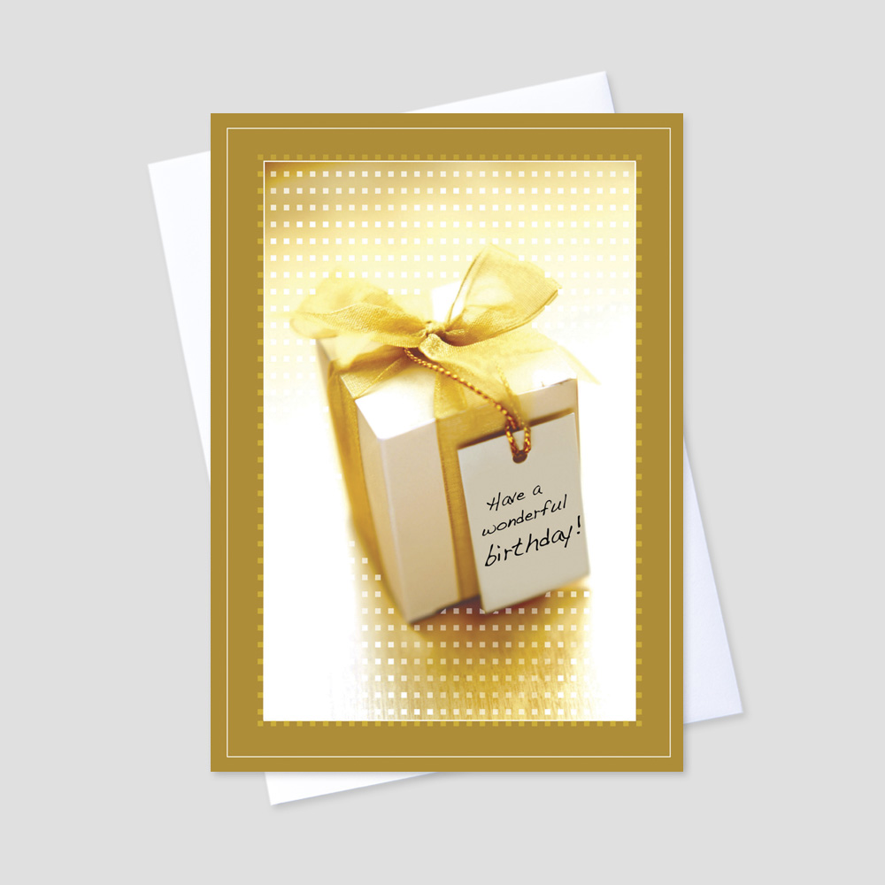Company Birthday greeting card featuring a golden colored present with a birthday wishes tag on a portrait background bordered by golden colored detail