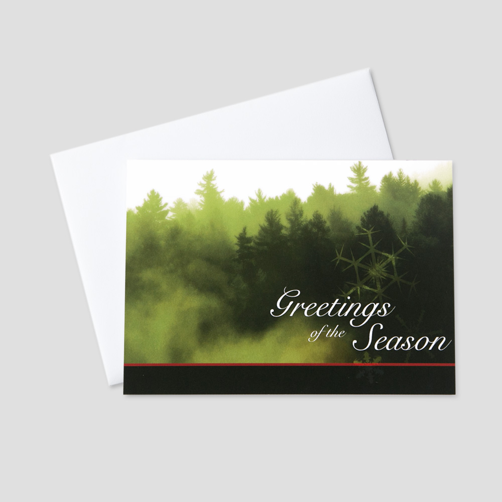 Corporate Holiday greeting card with an image of an evergreen forest and holiday message