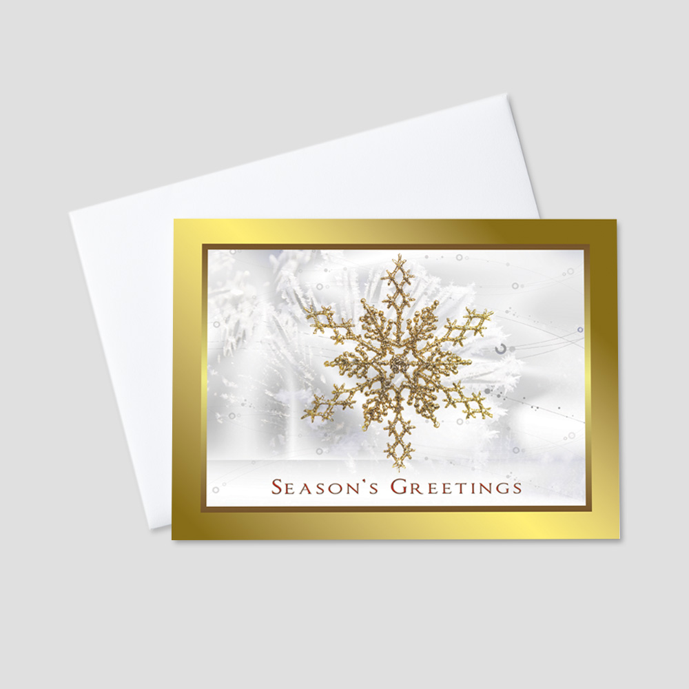 Corporate Holiday greeting card featuring a large golden colored snowflake in the center of the card with a season's greetings message printed in red with a matching golden and red border around the outside