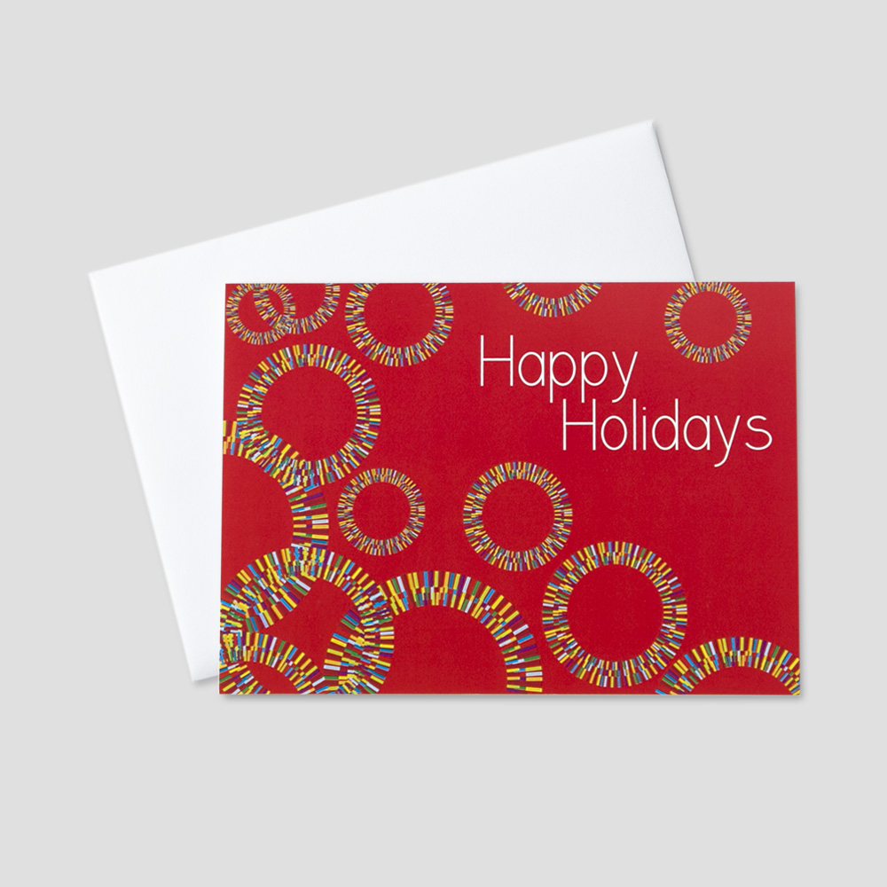 Festive Holiday greeting card with an image of colorful circles and happy holidays message
