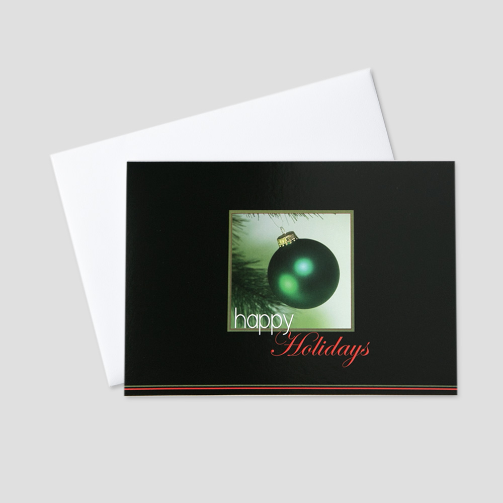 Business Holiday greeting card with an image or a green ornament and happy holidays message against a black border